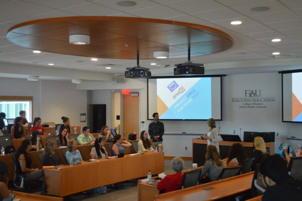 Alex Oliviera and Dr. Ann Root speaking to digital marketing students and nonprofit leaders.